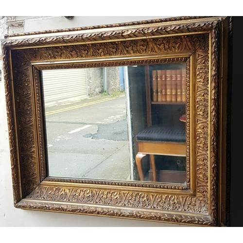 9 - A rectangular mirror in moulded gilt frame, 64 cms high, 64 cms wide....