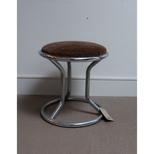 23 - A circular chrome stool with upholstered seat, 43 cms high, 43 cms diameter....