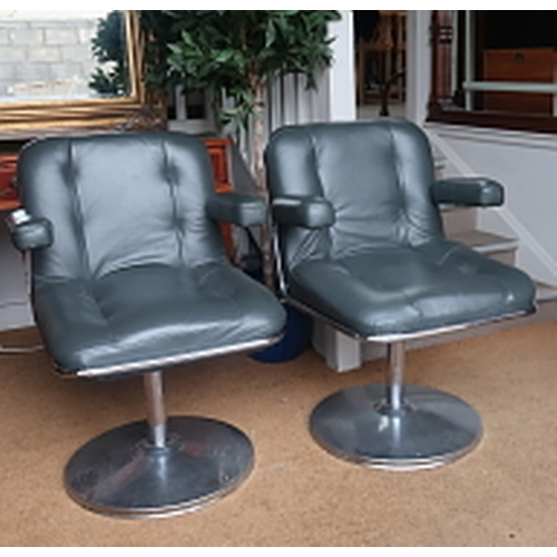 27 - A pair of leather upholstered and chrome office chairs, 86 cms high, 55 cms wide....