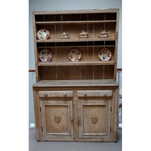 12 - A 19th Century pine dresser, the base with two drawers and two cupboard doors on plinth base, 203 cm...