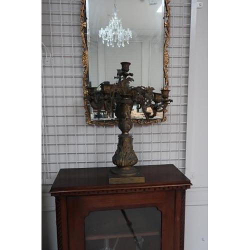 17 - A gilt metal six branch candelabrum, 52 cms high, 43 cms wide.