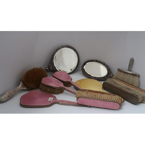 23 - A four piece silver mounted and pink enamel dressing set and various other part silver dressing tabl...