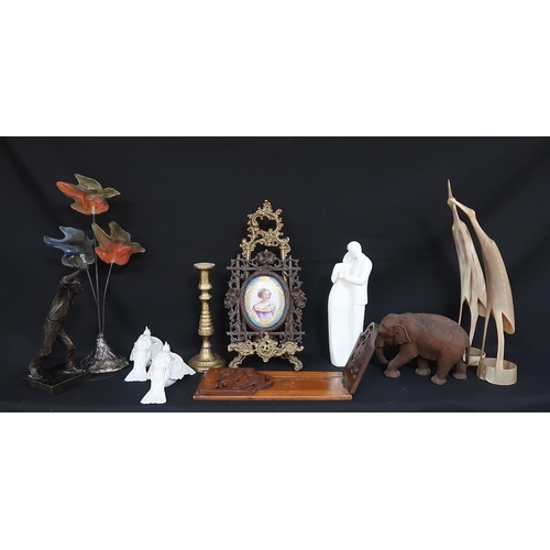 24 - A miscellaneous lot including a pair of bone ornaments modelled as birds, a carved figure of an elep...
