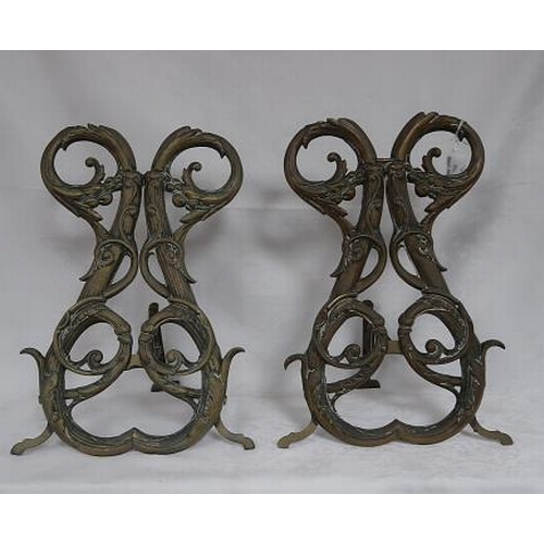 53 - A pair of French brass andirons, 28 cms wide, 45 cms high.