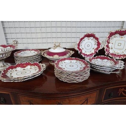 55 - A Victorian dessert service, the white ground decorated with plum border and gold motifs, 27 pieces.