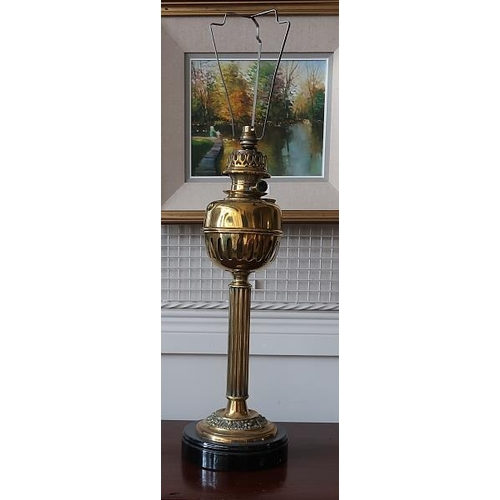 7 - A brass and copper standard lamp on concave supports with white circular marbleised shelf, & an Edwa...
