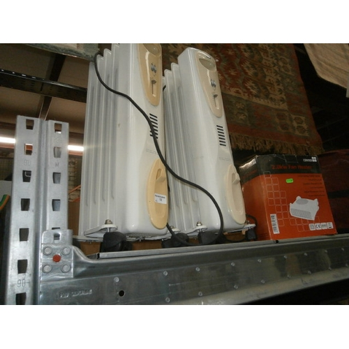 12 - Pair of oil filled radiators and fan heater...