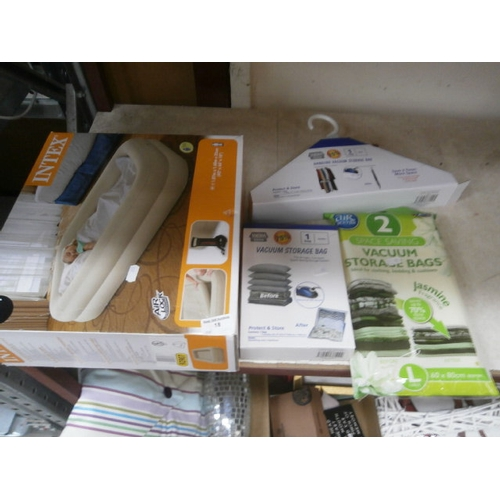 18 - Lot inc inflatable bed, vacuum storage bags and clothes hangers...