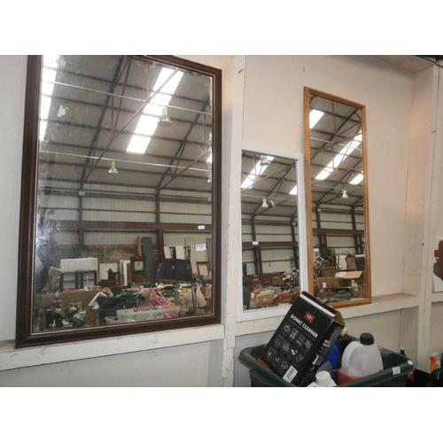 32 - Three wooden framed mirrors...
