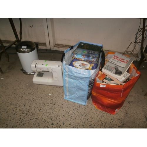 45 - Lot inc sewing machine, books, videos, etc...