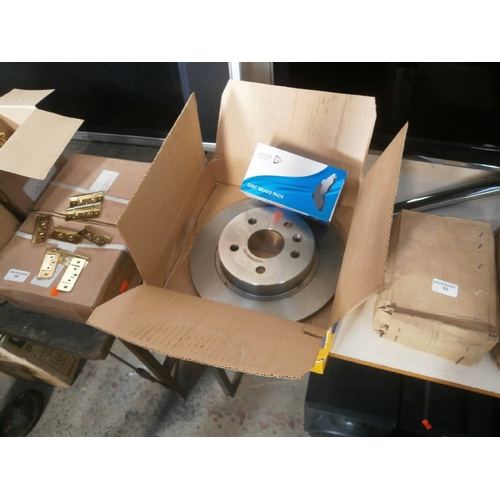 61 - Two boxes of brake discs and box of break pads...