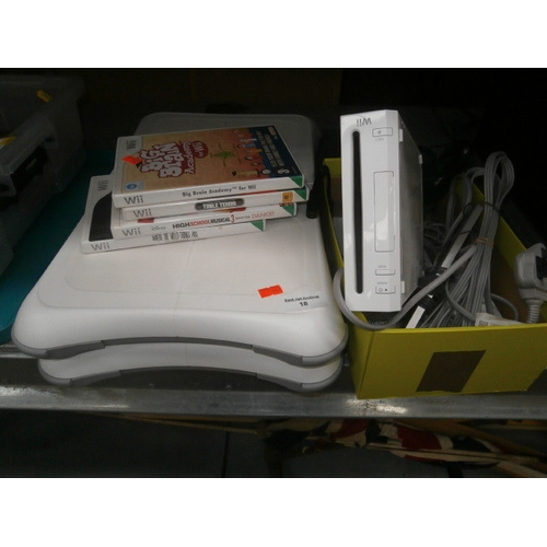 18 - Wii console with fit boards and games...
