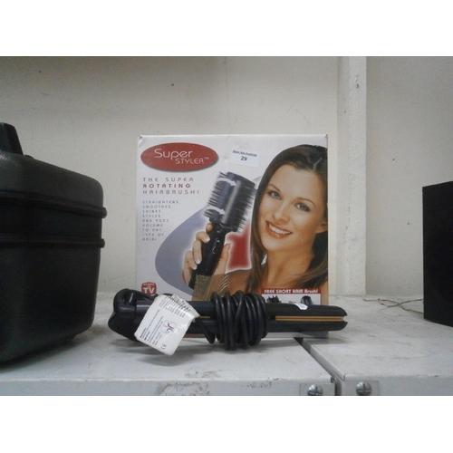 29 - Rotating hair brush and hair straighteners...