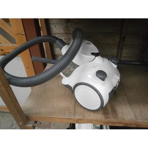 5 - Compact vacuum cleaner...