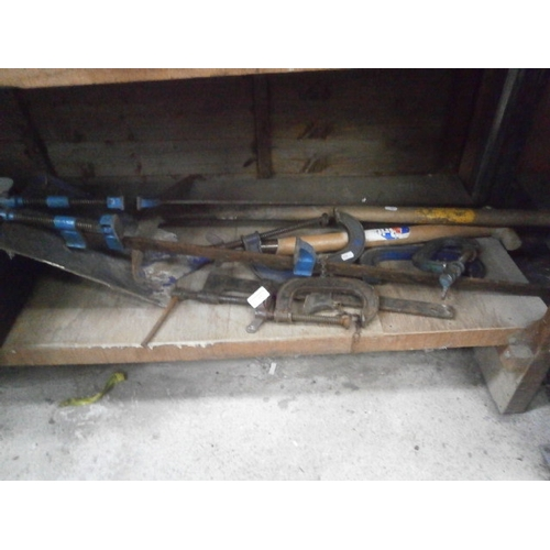 11 - Lot inc metal clamps, spade and pickaxe...