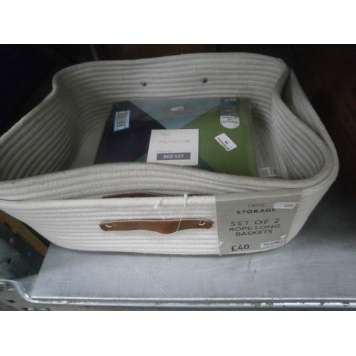 19 - Set of two rope long baskets and new printed bed sheet...