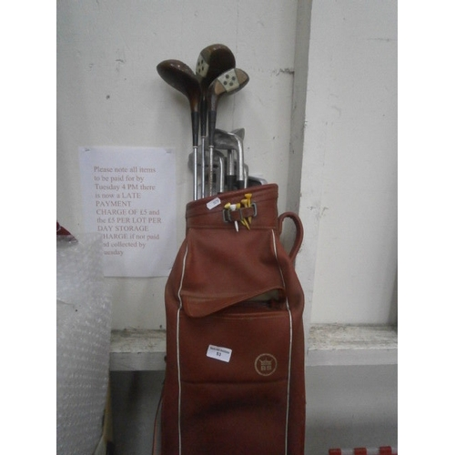 53 - Golf bag and selection of clubs...