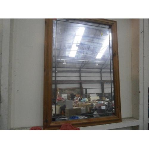 55 - Large pine framed mirror...