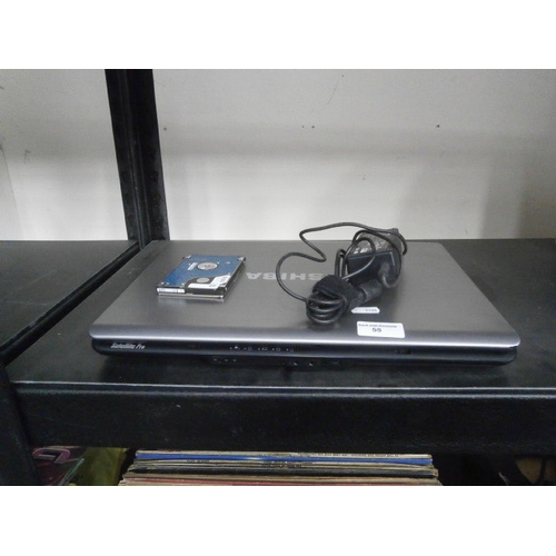 55 - Toshiba laptop with part charger...