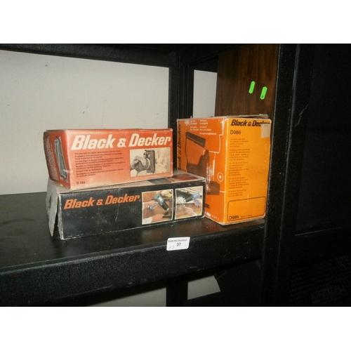 37 - Lot of three Black & Decker tools inc sander, heat gun, jigsaw...