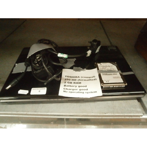 6 - Toshiba laptop with charger...