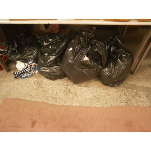 218 - Four bags of clothing...