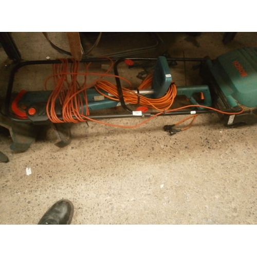 278 - Lot inc Bosch electric lawnmower and 2 Black & Decker grass trimmers...