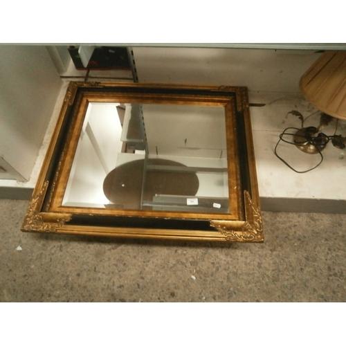 394 - Large ornate gilt framed bevel edged mirror...