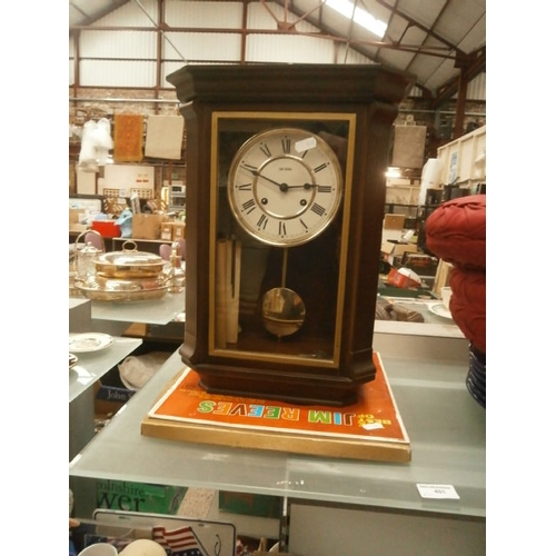 401 - Lot inc wall mounted clock and Jim Reeves vinyl...