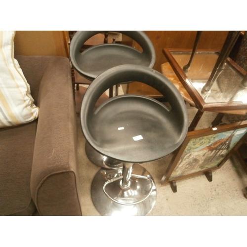 663 - Pair of chrome based bar stools...