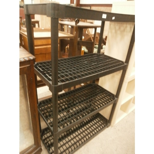 682 - 4 tier stacking plastic shelf stand...