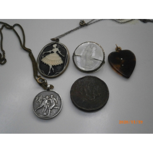 242 - Lot inc Tortoise shell pendant, Cameo pendant, old coins, silver football pendant etc...