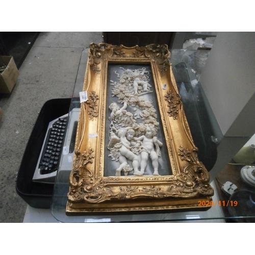 394 - Ornate gilt framed resin cherub picture...