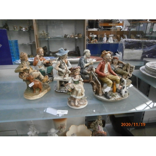 411 - Collection of various old time figurines...