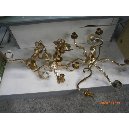 414 - Three brass light fittings...