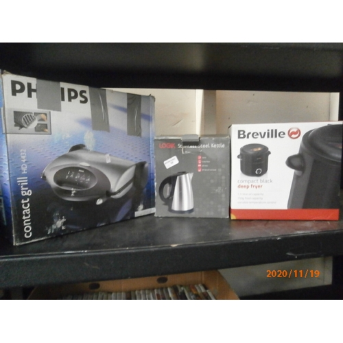 52 - Three boxed items inc Kettle, contact grill, deep fryer...