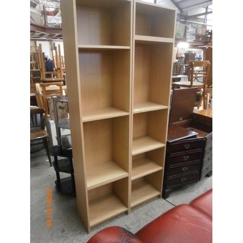 651 - Pair of tall open shelf units...