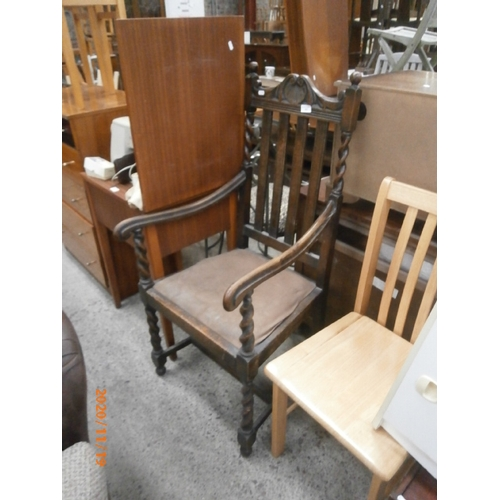 657 - Vintage carved oak elbow chair with Barley Twist supports...