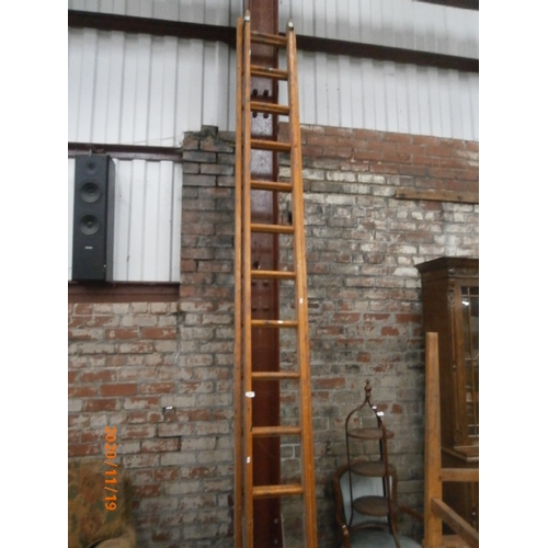 663 - Double extending 12ft wooden ladders...