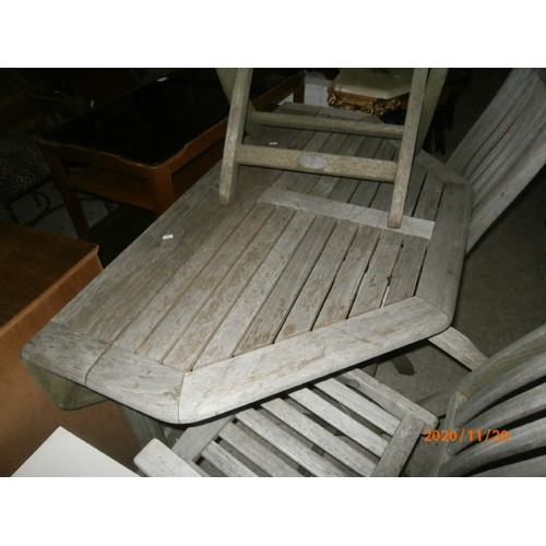 674 - Drop leaf wooden garden table and 3 x matching chairs...