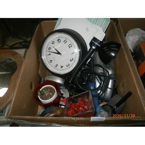 119 - Four boxes inc clocks, lamps, crockery, handheld vacuum, etc...