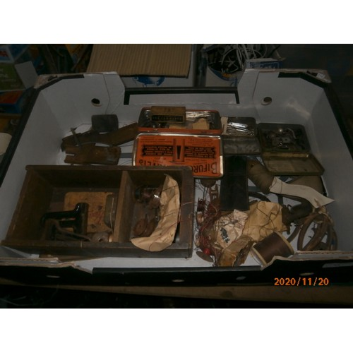 44 - Two boxes of industrial sewing machine parts...