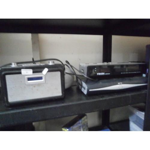 53 - 2 stereos , sky box & binatone alarm clock working...