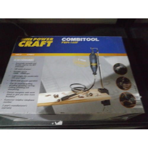 55 - power craft combitool with new accessory kit...
