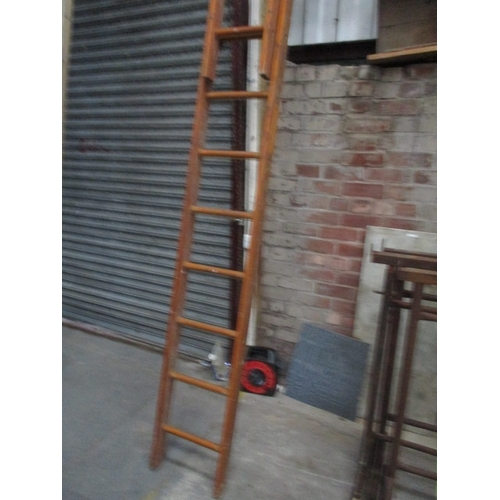 1002 - Double wooden extending ladder in good condition...