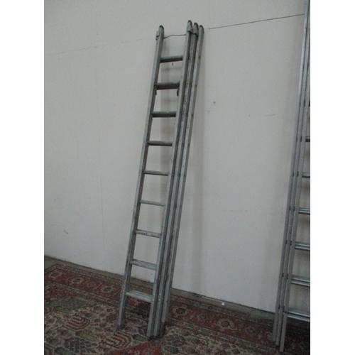 1042 - Triple aluminium 9 rung extending ladders...
