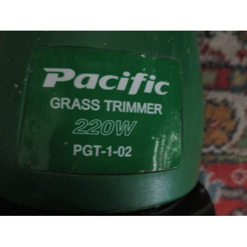 1056 - Pacific 220w grass trimmer, PGT-1-02 in working order...