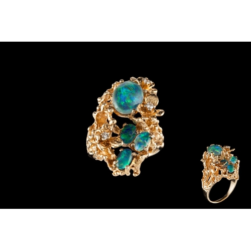 1 - A 14CT GOLD DRESS RING, set with diamonds, opal doublets and an opal triplet...