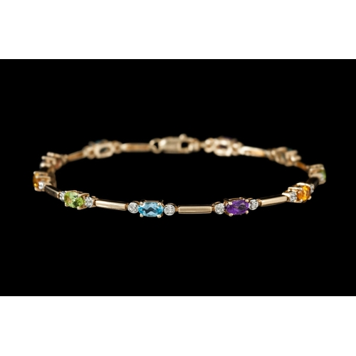 12 - A MULTI GEM AND DIAMOND BRACELET, mounted in yellow gold...