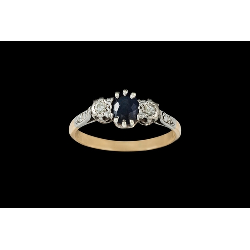 16 - A THREE STONE SAPPHIRE AN DIAMOND RING, mounted in 18ct yellow gold...